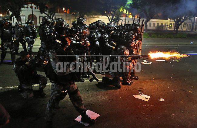 Demonstrators face the policemen during the riot on the streets of Rio, in front of the City Hall, Rio de Janeiro, Brazil, June 20, 2013. The people of this movement protest against official corruption and spending on next year's World Cup. (Austral Foto/Léo Corrêa)