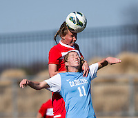 Kelly McFarlane (11) of North Carolina goes up for a header with Julia Roberts (13) of the Washington Spirit during the game at the Maryland SportsPlex in Boyds, MD.  The Washington Spirit defeated the North Carolina Tar Heels in a preseason exhibition, 2-0.