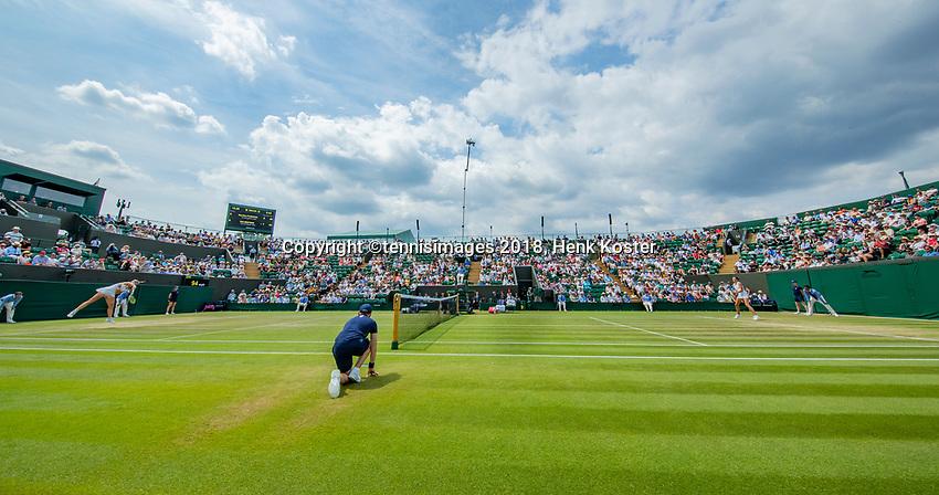 London, England, 9 th. July, 2018, Tennis,  Wimbledon, Womans single fourth round: Kiki Bertens (NED) in her match against Karolina Pliskova (CZE) (R)<br /> Photo: Henk Koster/tennisimages.com