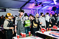 On left, Andy Bruder and Scott Pueringer with Team Struggle at the 5th Annual PBP Championship beer pong tournament at the 39th Annual International Eelpout Festival, at Leech Lake in Walker, Minnesota, February 24, 2018. Crowds that are more than 10 times the population of tiny Walker, Minn. (pop. 1,069) gather on Minnesota&rsquo;s third largest lake (112,000-acres), Leech Lake, for a festival named for one of the ugliest bottom-dwelling fish, the eelpout.<br /> <br /> Photo by Matt Nager