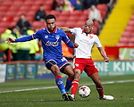 Aaron Holloway of Oldham Athletic tackled by Alex Baptiste of Sheffield Utd during the Sky Bet League One match at The Bramall Lane Stadium.  Photo credit should read: Simon Bellis/Sportimage