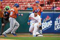 Buffalo Bisons first baseman Jesus Montero (48) stretches for a throw as Daniel Robertson (28) gets back to the bag during a game against the Durham Bulls on June 13, 2016 at Coca-Cola Field in Buffalo, New York.  Durham defeated Buffalo 5-0.  (Mike Janes/Four Seam Images)