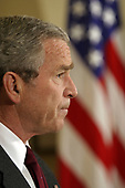 """Washington, D.C. - December 17, 2005 -- United States President George W. Bush uses his weekly radio address from the Roosevelt Room of the White House on Saturday, December 17, 2005 to confirm that he secretly signed an order authorizing the National Security Agency (NSA) to eavesdrop on the international communications of Americans and other domestic residents with known links to al Qaeda. He defended his decision, calling the program a """"vital tool in our war against terrorists"""" and """"critical to saving American lives."""" He said the program is reviewed every 45 days by the attorney general and White House counsel and that he has to reauthorize it. He has reauthorized it 30 times so far, he said, and """"I intend to do so for as long as our nation faces a threat"""" from al Qaeda. Without naming any, he also criticized news organizations for divulging the program, saying the disclosure """"damaged our national security.""""   The confirmation came as part of an unusually long, live radio address broadcast from the Roosevelt Room. The address lasted nearly 10 minutes and started out with a warning to the United States Senate to end the filibuster against the USA Patriot Act and approve it. He accused Senate Democrats, who are blocking reauthorization of the law, of putting Americans in danger.  """"That decision is irresponsible and it endangers the lives of our citizens. The senators who are filibustering must stop their delaying tactics."""" Noting that the act expires in two weeks, he said, """"The terrorist threat to our country will not expire in two weeks.""""<br /> Credit: Martin H. Simon - Pool via CNP"""
