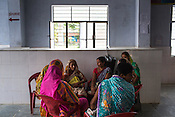 Women seen waiting to meet the doctor at the Public Health Centre in Adapur village of Raxaul district of Bihar.