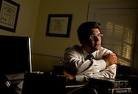 Environmental portrait of an attorney in his office in Charlotte, NC.