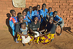 Women and their children in Kaluhoro, Malawi. With support from the Ekwendeni Hospital AIDS Program, villagers here participate in a Building Sustainable Livelihoods program, working together to earn and save money, raise more nutritious food, and receive vocational training.