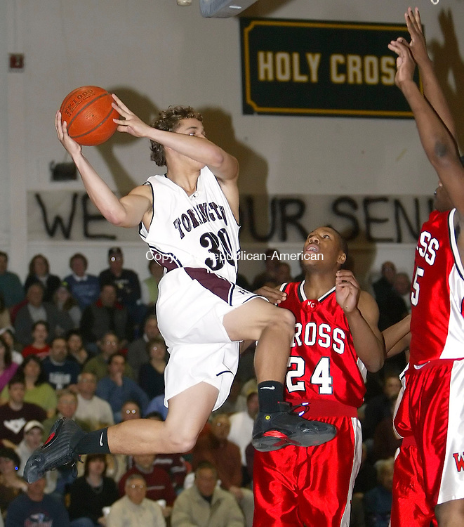 TORRINGTON, CT, 03/07/07- 030707BZ10-  Torrington's Ty Kittle (30) looks for the pass against Wilbur Cross's Markus Wright (24) and Demetrye Brown (45)<br /> during the second round Class LL tournament at Torrington High School Wednesday night.<br /> Jamison C. Bazinet Republican-American