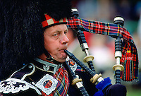Scottish Piper playing bagpipes at the Braemar Games, Braemar, Scotland