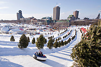 A young Reveller slides down a hill on the Plains of Abraham at the Carnaval de Quebec winter Carnival in Quebec City Wednesday February 13, 2013. The Carnaval de Quebec is one of the biggest winter festival in the World.