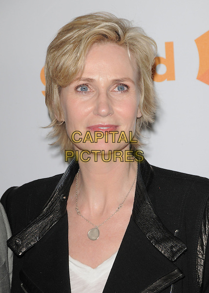 JANE LYNCH .at the 21st Annual GLAAD Media Awards held at The Hyatt Regency Century Plaza in Century City, California  USA, April 17th 2010.       .portrait headshot black white silver necklace .CAP/RKE/DVS.©DVS/RockinExposures/Capital Pictures.