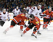Nicolas Gay (Switzerland - 3), Miks Lipsbergs (Latvia - 20), Tim Weber (Switzerland - 17) - Team Switzerland defeated Team Latvia 7-5 on Wednesday, December 30, 2009, at the Credit Union Centre in Saskatoon, Saskatchewan, during the 2010 World Juniors tournament.