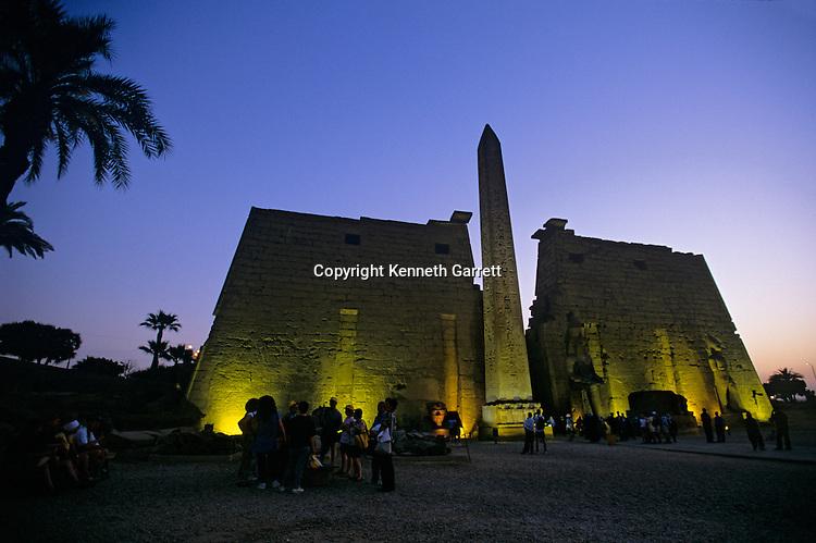 Temple of Luxor, front pylon, festival of Opet, colossal statue of Ramses II (the Great), red granite obelisk, pylon depicts Battle of Kadesh, Hittites, New Kingdom, Egypt, archaeology