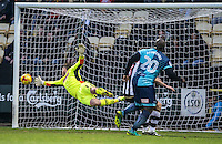 Adebayo Akinfenwa of Wycombe Wanderers flies past Goalkeeper Adam Collin of Notts Co during the Sky Bet League 2 match between Notts County and Wycombe Wanderers at Meadow Lane, Nottingham, England on 10 December 2016. Photo by Andy Rowland.
