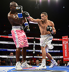 MIAMI, FL - JULY 10: Light Heavyweight and WBC ranked #3 Humberto 'El Don' Savigne (white short) and Jeff Lacy (pink short) in the ring fighting at the Iron Mike Judgement Day boxing match at AmericanAirlines Arena on July 10, 2014 in Miami, Florida. Savigne defeated Lacy in two rounds. (Photo by Johnny Louis/jlnphotography.com)