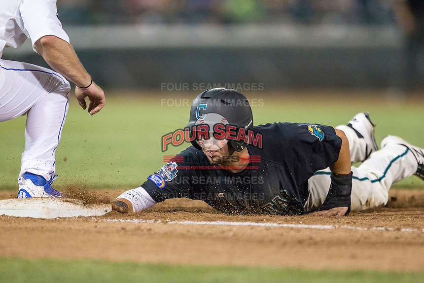 Coastal Carolina Chanticleers shortstop Michael Paez (1) dives back to first base against the Florida Gators in Game 4 of the NCAA College World Series on June 19, 2016 at TD Ameritrade Park in Omaha, Nebraska. Coastal Carolina defeated Florida 2-1. (Andrew Woolley/Four Seam Images)