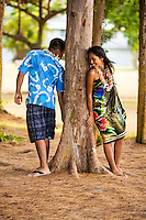 A young, engaged local couple in love at Kailua Beach Park, Windward O'ahu.
