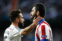 Atletico Madrid´s Turkish midfielder Arda Turan and Real Madrid's Spanish defense Dani Carvajal