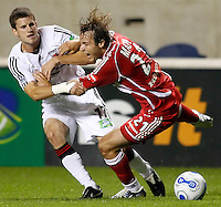 DC United midfielder Joshua Gros (17) fouls Chicago Fire midfielder Justin Mapp (21).  The Chicago Fire defeated the DC United 3-0 in the semifinals of the U.S. Open Cup at Toyota Park in Bridgeview, IL on September 6, 2006...