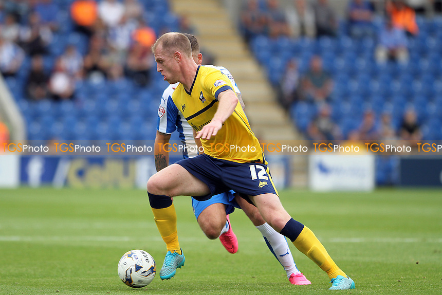Neil Bishop of Scunthorpe United challenged by George Moncur of Colchester United during Colchester United vs Scunthorpe United, Sky Bet League 1 Football at the Weston Homes Community Stadium, Colchester, England on 29/08/2015