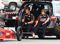 Aug. 3, 2013; Kent, WA, USA: NHRA crew members for top fuel dragster driver David Grubnic sitting on the back of their tow vehicle during qualifying for the Northwest Nationals at Pacific Raceways. Mandatory Credit: Mark J. Rebilas-USA TODAY Sports