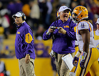11/14/15<br /> Arkansas Democrat-Gazette/STEPHEN B. THORNTON<br /> LSU coach Les Miles, left, watches as his game slips away in the third quarter during their game Saturday in Baton Rouge, La.