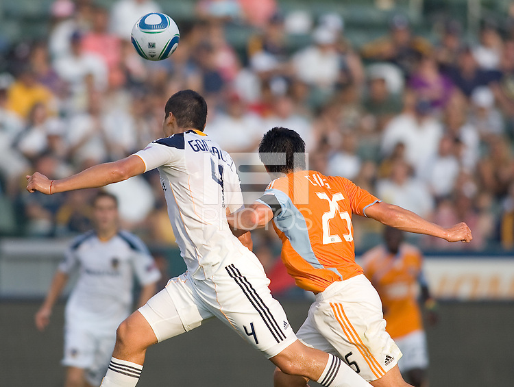 LA Galaxy defender Omar Gonzalez (28) battled Houston Dynamo forward Brian Ching (25) fall match long. The LA Galaxy defeated the Houston Dynamo 4-1 at Home Depot Center stadium in Carson, California on Saturday evening June 5, 2010..
