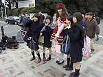 group of schoolgirls with a fairy tale costumed person Yoyogi park Harajuku Tokyo Japan