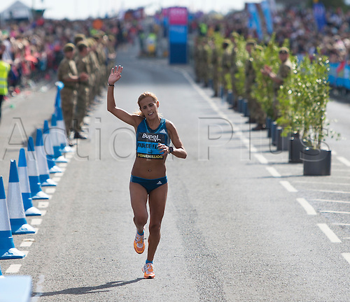 07.09.2014.  South Shields, England.  BUPA Great North Run. Ana Dulce Felix waves to fans as she finishes the Great North Run.