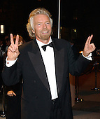Sir Richard Branson, Chairman and CEO, Virgin Group, arrives for the party hosted by Bloomberg News following the 2003 White House Correspondents Dinner in Washington, DC on April 26, 2003.<br /> Credit: Ron Sachs / CNP