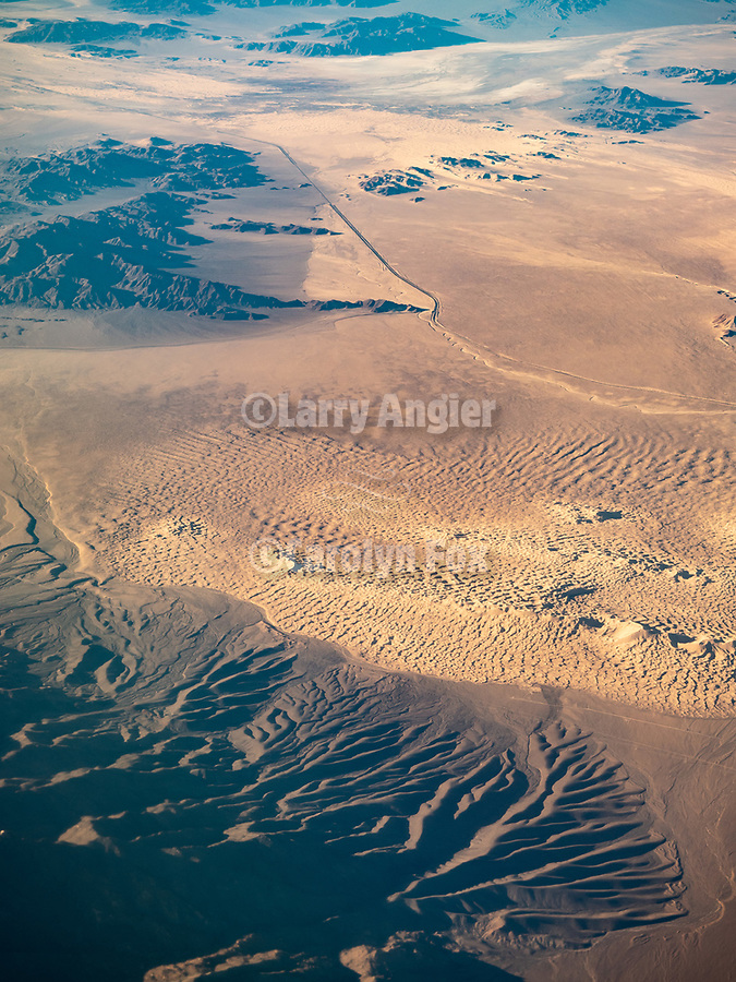 Dunes in the Mojave Desert, from a window seat on a United Airlines flight from Chicago to Los Angeles over America's Flyover County.