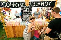 NWA Democrat-Gazette/DAVID GOTTSCHALK  John Lederman (top right) serves samples of Twist Candy Company cotton candy Monday September 7, 2015 to Stephanie Lovett (from left), Kyleeh (cq), 6, Tannen, 2, and Johnny, all of Prairie Grove at the 64th annual Clothesline Fair at Prairie Grove Battlefield State Park. The candy company serves a variety of cotton candy flavors including Sugar Cookie, Chocolate Dipped Strawberry and Battlefield Blast.
