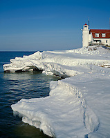 Benzie County, MI          <br /> Point Betsie Lighthouse above the ice packed shoreline on Lake Michigan