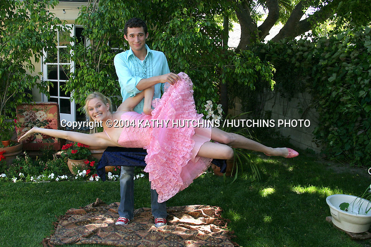 "©2004 KATHY HUTCHINS /HUTCHINS PHOTO.NICHOLLE TOM AND JUSTIN WILLMAN (STAGE NAME .""JUSTIN KREDIBLE"") AT THEIR MAGICAL HOME.LOS ANGELES, CA.APRIL 23, 2004..NICHOLLE TOM.JUSTIN WILLMAN"