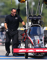 Sep 28, 2013; Madison, IL, USA; A crew member for NHRA top fuel dragster driver Steve Torrence during qualifying for the Midwest Nationals at Gateway Motorsports Park. Mandatory Credit: Mark J. Rebilas-