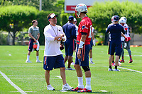June 13, 2017: New England Patriots offensive coordinator Josh McDaniels (left) talks to quarterback Tom Brady (12) at the New England Patriots organized team activity held on the practice field at Gillette Stadium, in Foxborough, Massachusetts. Eric Canha/CSM