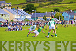 Bryan Sheehan is hauled to the ground by Shane Curtin of St Kiernans resulting in another easy point from the spot for Bryan Sheehan.