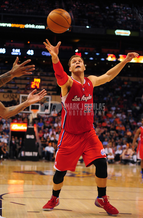 Apr. 19, 2012; Phoenix, AZ, USA; Los Angeles Clippers forward (32) Blake Griffin reaches for a rebound in the first half against the Phoenix Suns at the US Airways Center. The Suns defeated the Clippers 93-90. Mandatory Credit: Mark J. Rebilas-.