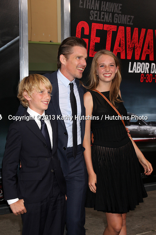 """LOS ANGELES - AUG 26:  Ethan Hawke, his children at the """"Getaway"""" Premiere at the Village Theater on August 26, 2013 in Westwood, CA"""