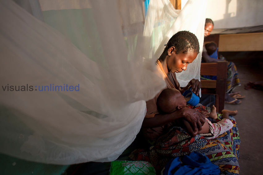Mother holding malnourished child at MSF hospital in Central African Republic
