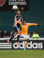 Marcelo Saragosa (11) of D.C. United goes up for a header with Boniek Garcia (27) of Houston Dynamo during the game at RFK Stadium in Washington,DC. D.C. United tied the Houston Dynamo, 1-1.  With the tie, Houston won the Eastern Conference and advanced to the MLS Cup.