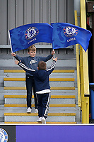 A couple of young Chelsea supporters amuse themselves during Chelsea Ladies vs Liverpool Ladies, FA Women's Super League FA WSL1 Football at Kingsmeadow on 7th October 2017