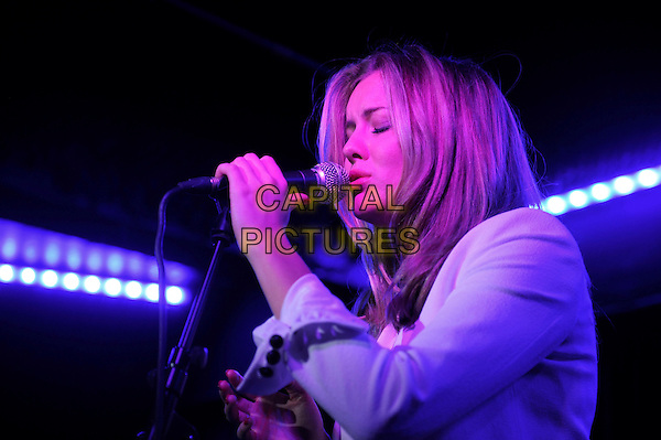 Caggie Dunlop performing in concert, Borderline, London, England. <br /> 9th October 2013<br /> on stage live gig performance music half length white blazer top singing profile <br /> CAP/MAR<br /> &copy; Martin Harris/Capital Pictures