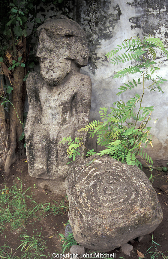 Pre-Columbian stone statue and petroglyphs from Isla de Ometepe, Nicaragua. Courtyard of El Museo Ometepe in Altagracia.