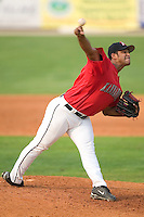 Kannapolis Intimidators relief pitcher Alex Farfan fires the ball to the plate versus the Greenville Drive at Fieldcrest Canon Stadium in Kannapolis, NC, Sunday, July 9, 2006.