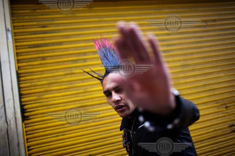 A punk wears a mohawk style haircut.