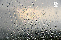 Car windshield with water drops on stormy sky  (Licence this image exclusively with Getty: http://www.gettyimages.com/detail/100378207 )