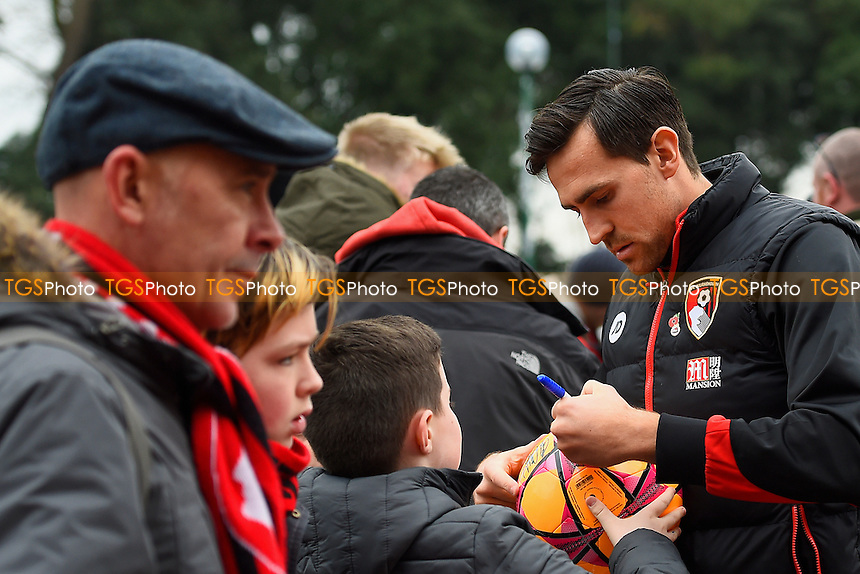 Charlie Daniels of AFC Bournemouth signs a ball for a young fan during AFC Bournemouth vs Watford, Premier League Football at the Vitality Stadium on 21st January 2017