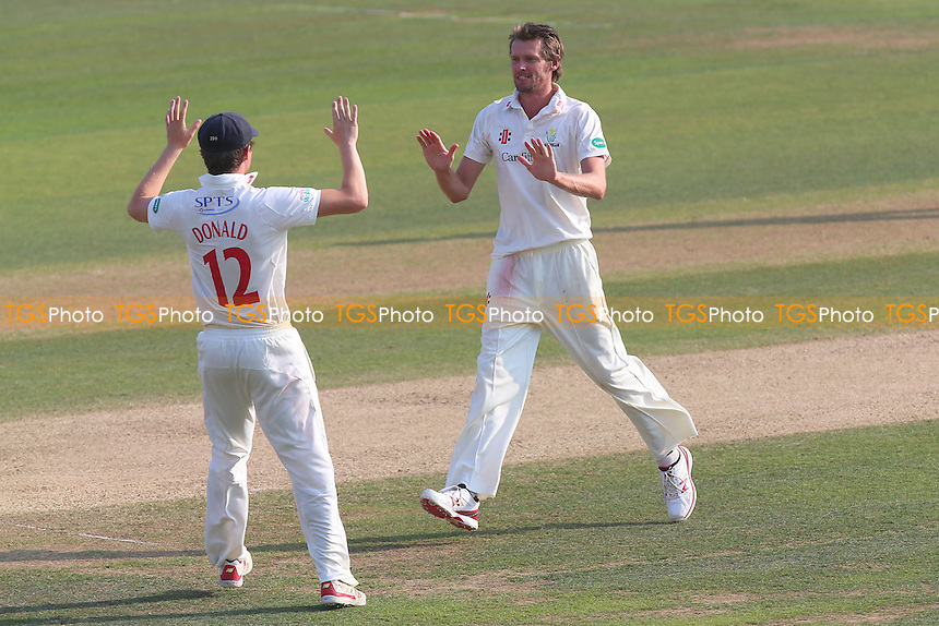 Michael Hogan (R) of Essex celebrates taking the wicket of Ryan ten Doeschate during Essex CCC vs Glamorgan CCC, Specsavers County Championship Division 2 Cricket at the Essex County Ground on 15th September 2016