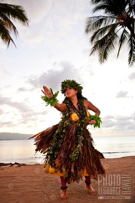 Kahiko hula dancer on the beach at Haleiwa on Oahuʻs north shore.
