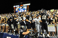 17 September 2011:  FIU players (pictured, defensive line Paul Crawford (92), wide receiver Wayne Times (5), linebacker Markeith Russell (22), linebacker Caleb Vincent (42), wide receiver Rockey Vann (89), and wide receiver Glenn Coleman (10)) climb into the stands to celebrate with fans after the FIU Golden Panthers defeated the University of Central Florida Golden Knights, 17-10, at FIU Stadium in Miami, Florida.